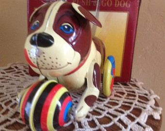 Vintage Metal Tin Toy Push And Go Dog Pushing tail down makes dog go- 1998