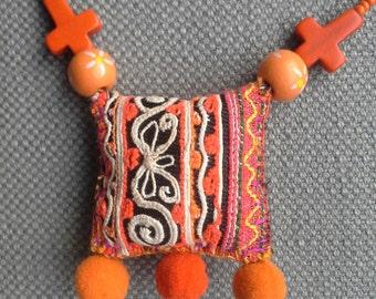 Textile necklace, talisman. Citrus colors.