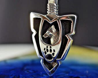 Sterling silver Navajo Designed Arrowhead pendant with a shadowbox Wolf & Wolf Paw