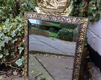 Beautiful gold ornate mirror with lovely ship detail in the frame.