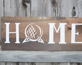Disney's Epcot Home Sign on Stained Wood