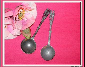 Two decorative pewter spoons.
