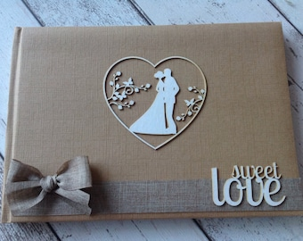 Rustic Wedding Guestbook with burlap hessian trim. Personalised with Bride & Grooms names and wedding date if requested.