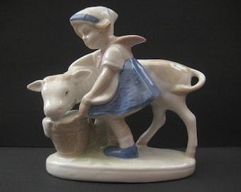 Vintage porcelain figurine, girl feeding cow, V.E.B. Porzellanfiguren Lippelsdorf GDR figurine, made in Germany.