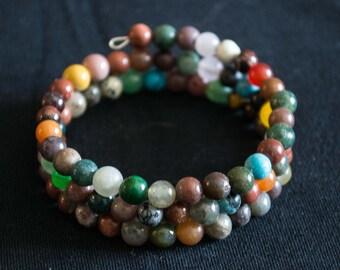Natural round stone memory coil bracelet