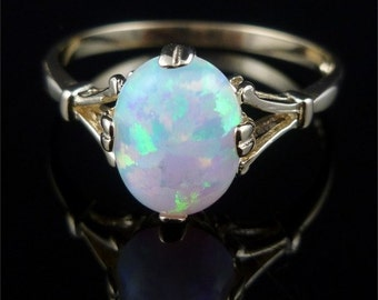 Beautiful Opal Solitaire Gold Ring