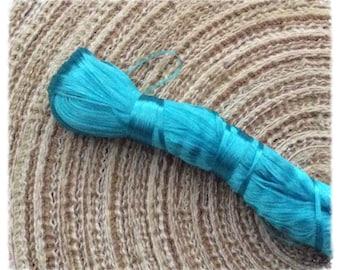 2 turquoise blue silk thread spools