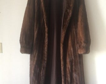 Long beautiful winter real mink fur coat, size large .