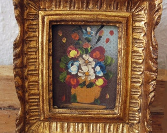 Little flower picture with gold-colored frame