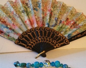 Fan with bead string
