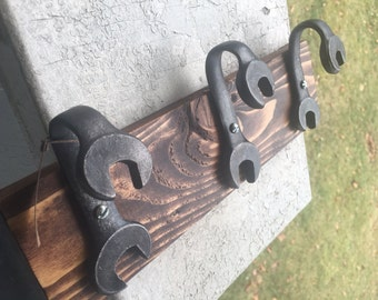 Reclaimed Wrench Hooks on Pallet Wood