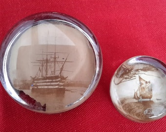 Paperweights,  2 x Victorian glass weights,  HMS Victory, war ship, and a junk boat. early 20th century. Home decor,