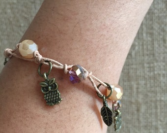 Charm bracelet, Owl bracelet, Feather bracelet. Hand knotted glass beads in leaher cord