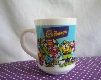 Christmas Cadbury Arcopal france, milk glass cup,mug. A late 80s/90s Nostalgic cadbury's cup depicting santa and elves with presents.