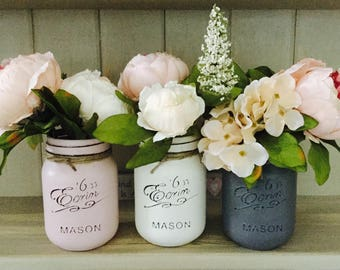 Set of 3 500ml painted mason jars. Great for decoration in your home or as a gift.