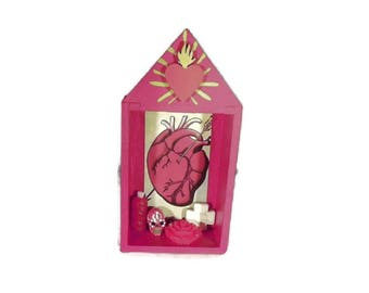 Red El Corazon shrine nicho with flaming heart