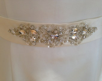An ivory wedding dress belt beaded on duchesse satin material for a bride crystal beads vintage look