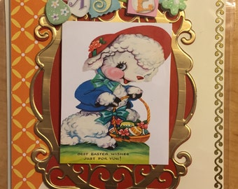 Handmade beautiful lamb carrying a basket of colorful eggs with die cut and embossed border Easter card