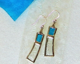 Turquoise earrings in stained glass