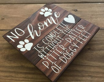 No home is complete without the pitter-patter of doggy feet reclaimed wood sign