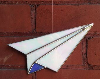 Iridescent paper airplane stained glass suncatcher