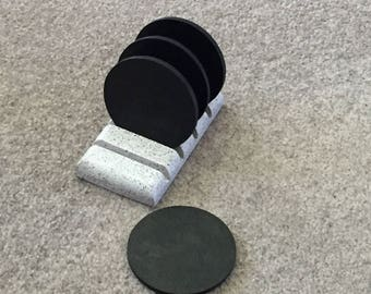Decorative black laminate coasters and a stone textured finish holder