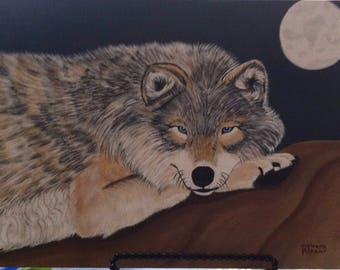 Hand painted Wolf lying on a rock under a full moon evening on canvas