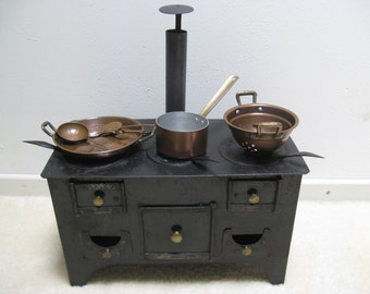 An antique German stove you with pans and various utensils from c.1900!