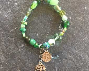 Green glass beaded stretchy bracelet with silver tree of life charms - stretchy