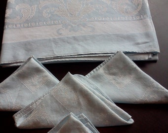 Vintage pale blue tablecloth measuring 60 x 46inches.  Four matching napkins.
