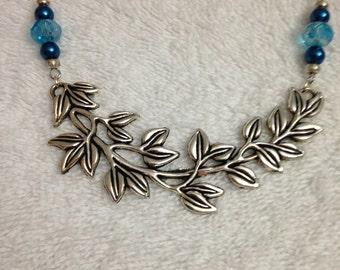 Branch/leaf necklace.
