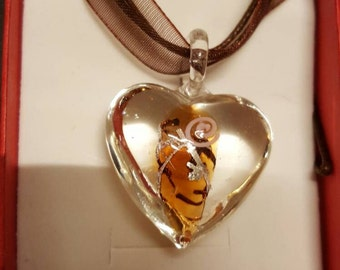 Clear blown glass with slight brown pattern in centre of heart necklace with organza ribbon