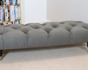 Deep buttoned long footstool in Suede