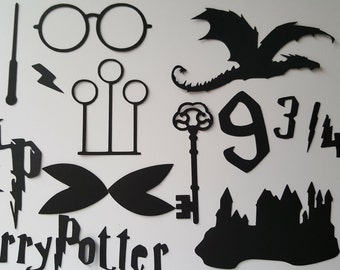 Harry Potter Die cut set containing 15 elements including a key with wings, platform 9 3/4, lightening, Hogwarts, dragon