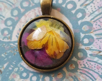 Violet and Verbena resin and bronze metal pendant. Orange, purple, yellow.