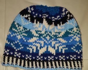 Frozen snowflakes messy bun hat.