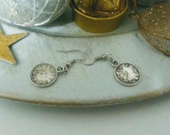 Small earrings in watch design. Silver earrings minimalist design