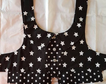Dog vest in black with white stars and a hint of pink or grey. Dog harness.