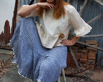 striped blue and white pleated and frilled skirt.Waistband and side zip. 1970's AUS sz 12.