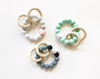 Silicone teething ring rattle baby toy