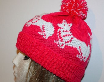 Cerise Pink pompom beanie hat with White Corgi dogs