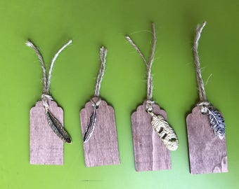 Wooden gift tags with metal feather embellishments