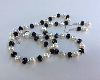 Classy faux pearl necklace and earrings with black and crystal beads