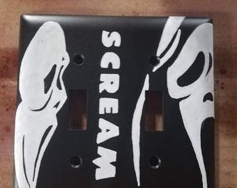 Scream double light switch cover