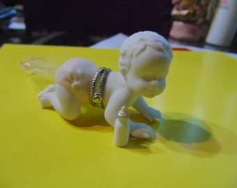 MFC Large bisque baby trinket box with bottle as a trinket