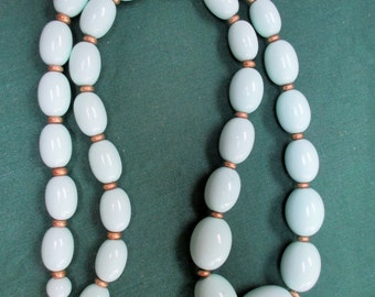 """A vtg.lucite beaded necklace in robins egg blue-goldtone spacers--22"""" end to end"""
