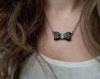 Gunmetal gray bow pendant necklace