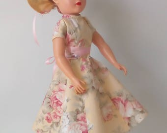 18 inch Miss Revlon doll dress. Yellow dress with floral pattern and matching hat.