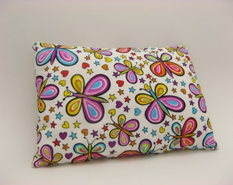 Small cushion in fabric, colorful butterflies on white background, cushion for child, child's room decoration
