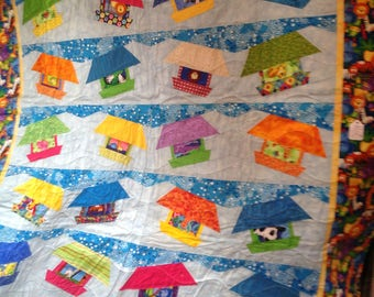 This is a machine pieced and quilted quilt.  Good for baby or toddler boy.   48x52.